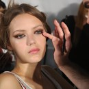 NEW YORK, NY - SEPTEMBER 06:  A model prepares backstage at the Jill Stuart fashion show during Mercedes-Benz Fashion Week Spring 2015 at Location 05 Studios on September 6, 2014 in New York City.  (Photo by Cindy Ord/Getty Images)